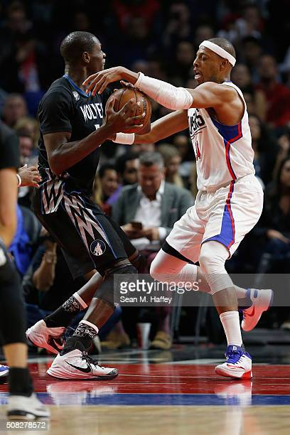 Gorgui Dieng of the Minnesota Timberwolves attempts to pass past Paul Pierce of the Los Angeles Clippers during the second half of a game at Staples...
