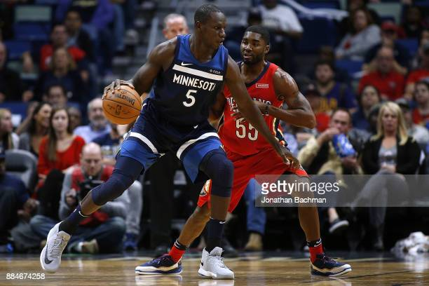 Gorgui Dieng of the Minnesota Timberwolves drives against E'Twaun Moore of the New Orleans Pelicans during the first half of a game at the Smoothie...