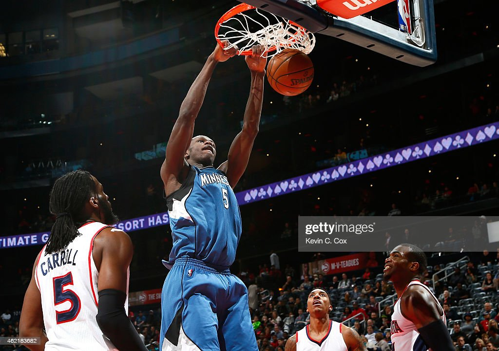 Gorgui Dieng #5 of the Minnesota Timberwolves dunks against DeMarre Carroll #5, Jeff Teague #0 and Paul Millsap #4 of the Atlanta Hawks at Philips Arena on January 25, 2015 in Atlanta, Georgia.