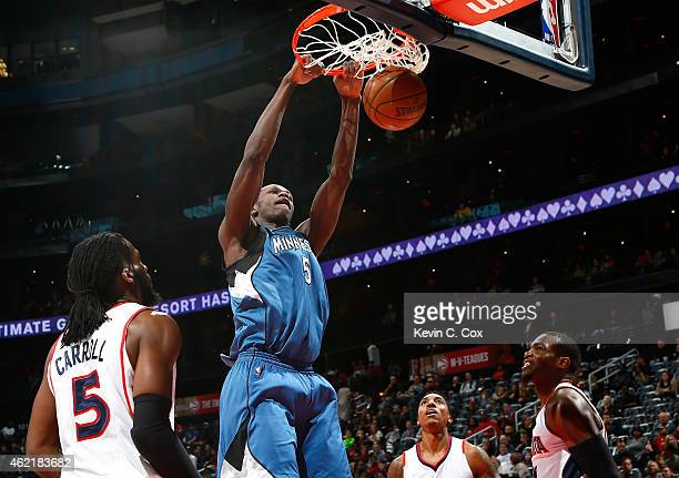 Gorgui Dieng of the Minnesota Timberwolves dunks against DeMarre Carroll Jeff Teague and Paul Millsap of the Atlanta Hawks at Philips Arena on...