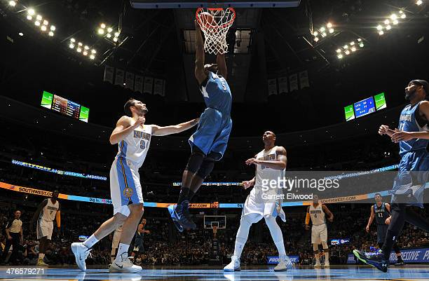Gorgui Dieng of the Minnesota Timberwolves dunks during a game against the Denver Nuggets on March 3 2014 at the Pepsi Center in Denver Colorado NOTE...