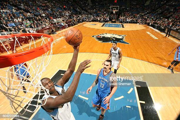 Gorgui Dieng of the Minnesota Timberwolves goes to the basket against the Oklahoma City Thunder on January 12 2016 at Target Center in Minneapolis...