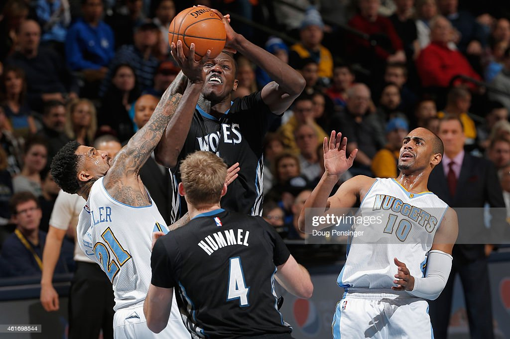 Gorgui Dieng #5 of the Minnesota Timberwolves goes up for a shot and is fouled by Wilson Chandler #21 of the Denver Nuggets at Pepsi Center on January 17, 2015 in Denver, Colorado. The Timberwolves defeated the Nuggets 113-105.