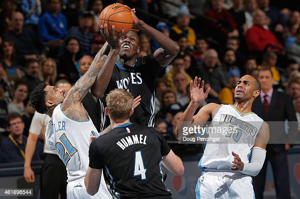Gorgui Dieng of the Minnesota Timberwolves goes up for a shot and is fouled by Wilson Chandler of the Denver Nuggets at Pepsi Center on January 17...