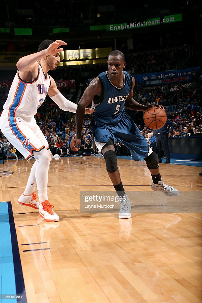 <a gi-track='captionPersonalityLinkClicked' href=/galleries/search?phrase=Gorgui+Dieng&family=editorial&specificpeople=7363274 ng-click='$event.stopPropagation()'>Gorgui Dieng</a> #5 of the Minnesota Timberwolves handles the ball against <a gi-track='captionPersonalityLinkClicked' href=/galleries/search?phrase=Enes+Kanter&family=editorial&specificpeople=5621416 ng-click='$event.stopPropagation()'>Enes Kanter</a> #34 of the Oklahoma City Thunder on March 13, 2015 at the Chesapeake Energy Arena in Oklahoma City, Oklahoma.