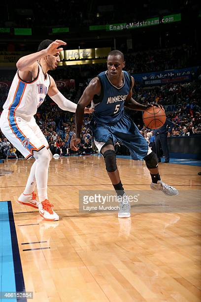 Gorgui Dieng of the Minnesota Timberwolves handles the ball against Enes Kanter of the Oklahoma City Thunder on March 13 2015 at the Chesapeake...