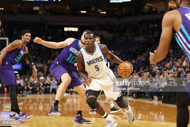 Gorgui Dieng of the Minnesota Timberwolves handles the ball against the Charlotte Hornets on October 21 2016 at Target Center in Minneapolis...