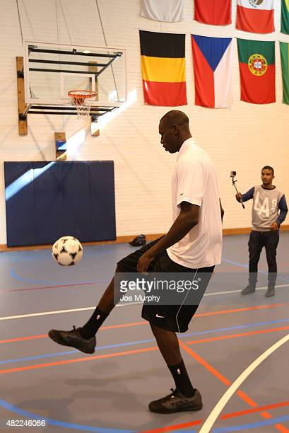 Gorgui Dieng of the Minnesota Timberwolves plays with a soccer ball prior to the opening press conference of the Basketball Without Boarders program...