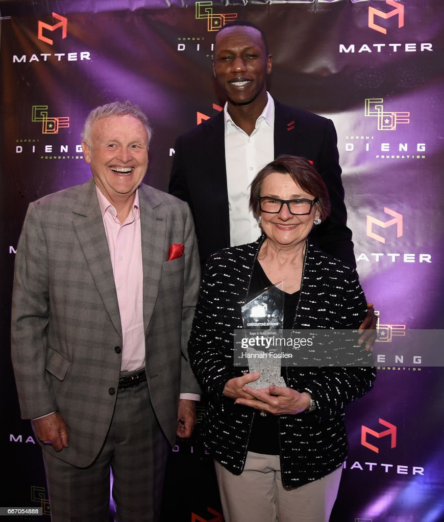 Gorgui Dieng #5 of the Minnesota Timberwolves poses for a photo with honorees Roger and Nancy McCabe during MATTER Presents: The Gorgui Dieng Project on April 10, 2017 in Wayzata, Minnesota.