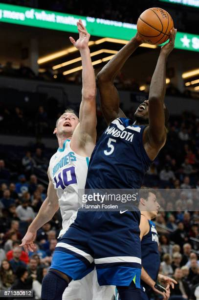 Gorgui Dieng of the Minnesota Timberwolves rebounds against Cody Zeller of the Charlotte Hornets during the game on November 5 2017 at the Target...