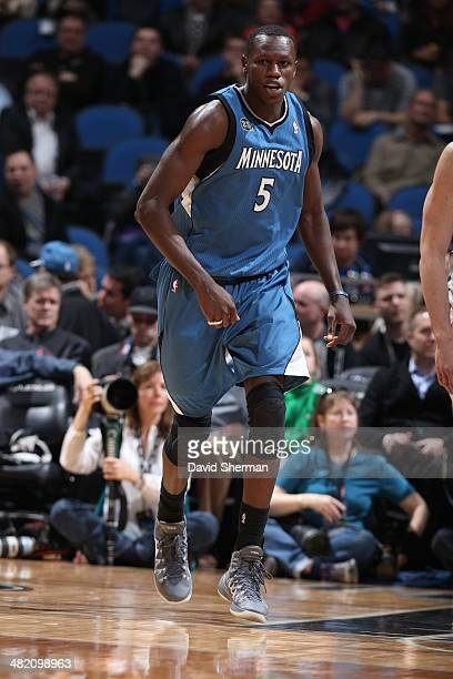 Gorgui Dieng of the Minnesota Timberwolves runs down the court during a game against the Memphis Grizzlies on April 2 2014 at Target Center in...