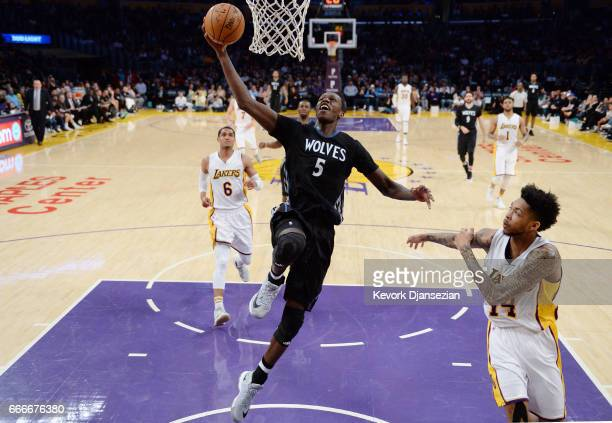 Gorgui Dieng of the Minnesota Timberwolves scores a basket over Brandon Ingram of the Los Angeles Lakers during the second half of the basketball...