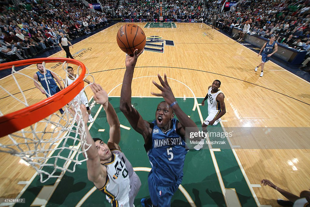 <a gi-track='captionPersonalityLinkClicked' href=/galleries/search?phrase=Gorgui+Dieng&family=editorial&specificpeople=7363274 ng-click='$event.stopPropagation()'>Gorgui Dieng</a> #5 of the Minnesota Timberwolves shoots against Enes Kanter #0 of the Utah Jazz at EnergySolutions Arena on February 22, 2014 in Salt Lake City, Utah.
