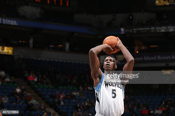 Gorgui Dieng of the Minnesota Timberwolves shoots the ball against the Philadelphia 76ers during the game on October 10 2014 at Target Center in...