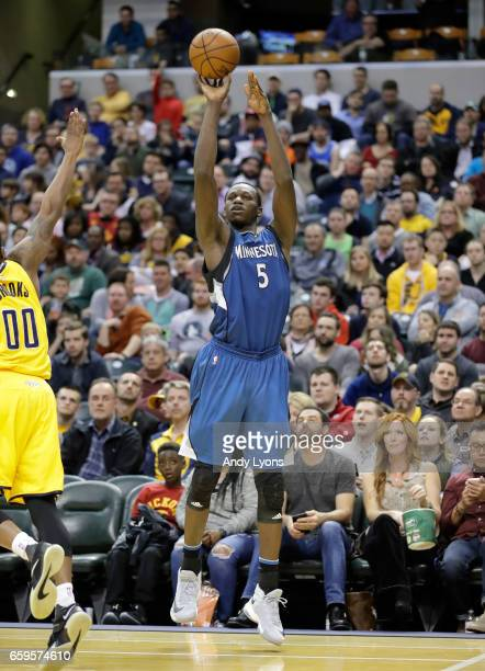 Gorgui Dieng of the Minnesota Timberwolves shoots the ball against the Indiana Pacers at Bankers Life Fieldhouse on March 28 2017 in Indianapolis...