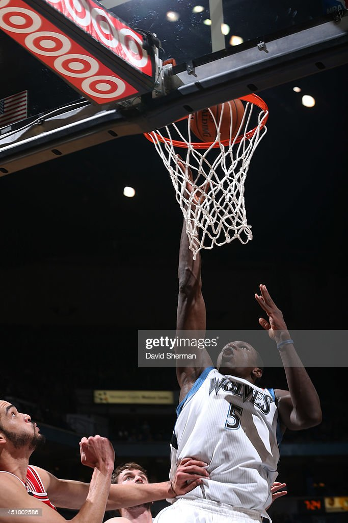 <a gi-track='captionPersonalityLinkClicked' href=/galleries/search?phrase=Gorgui+Dieng&family=editorial&specificpeople=7363274 ng-click='$event.stopPropagation()'>Gorgui Dieng</a> #5 of the Minnesota Timberwolves takes a shot against the Chicago Bulls during the game on April 9, 2014 at Target Center in Minneapolis, Minnesota.