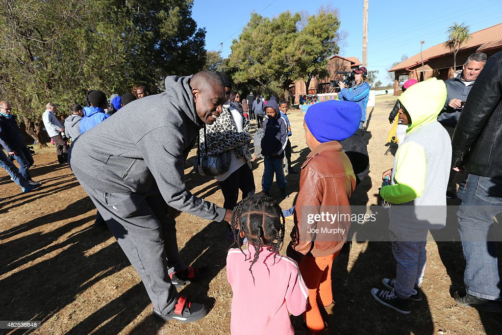 Gorgui Dieng #5 of the the Minnesota Timberwolves interacts with the children during the NBA Cares Court Dedication as part of the Basketball Without Boarders program on July 31, 2015 at the SOS Children's Village in Ennerdale, South Africa.