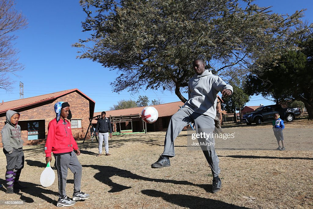 Gorgui Dieng #5 of the the Minnesota Timberwolves plays soccer with the children during the NBA Cares Court Dedication as part of the Basketball Without Boarders program on July 31, 2015 at the SOS Children's Village in Ennerdale, South Africa.