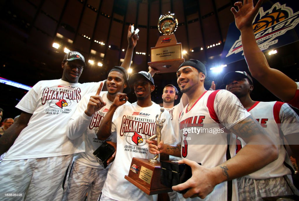 Gorgui Dieng #10, Wayne Blackshear #20, Russ Smith #2, Luke Hancock (holding trophy) #11, Peyton Siva #3 and Michael Baffour #32 of the Louisville Cardinals celebrate after they won 78-61 in overtime against the Syracuse Orange during the final of the Big East Men's Basketball Tournament at Madison Square Garden on March 16, 2013 in New York City.