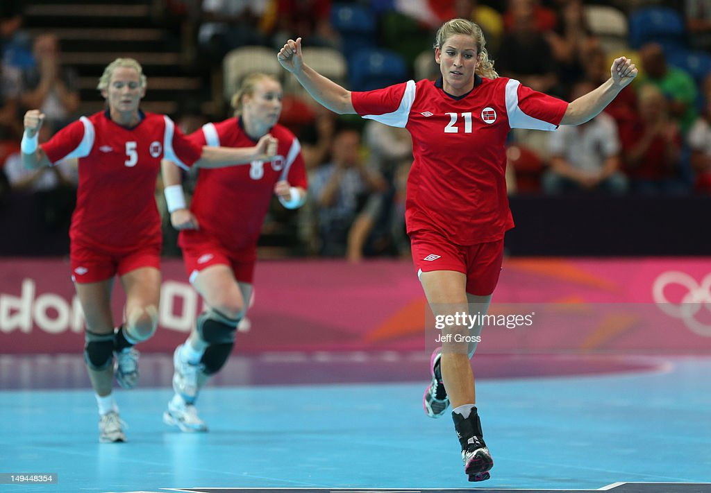 Goril Snorroeggen of Norway celebrates scoring a goal in the Women's Handball preliminaries Group B - Match 6 between Norway and France on Day 1 of the London 2012 Olympic Games at the Copper Box on July 28, 2012 in London, England.