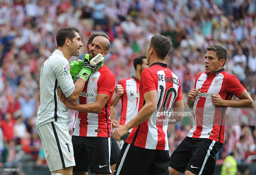 Gorka Iraizoz of Athletic Club is congratulates by teammates after saving a penalty kick by Lionel Messi of FC Barcelona during the La Liga match...
