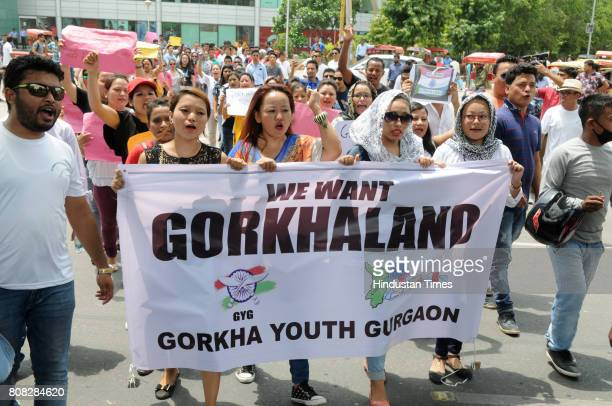 Gorkha youth hold a protest rally at MG road in support of separate Gorkhaland in Darjeeling on July 4 2017 in Gurgaon India