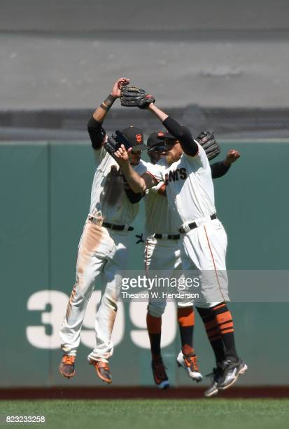 Gorkys Hernandez Denard Span and Hunter Pence of the San Francisco Giants celebrates defeating the Pittsburgh Pirates 21 at ATT Park on July 26 2017...
