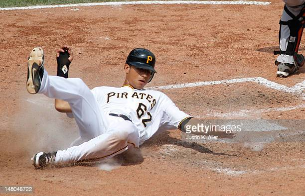 Gorkys Hernandez of the Pittsburgh Pirates scores in the sixth inning on a throw error by the San Francisco Giants during the game on July 8 2012 at...