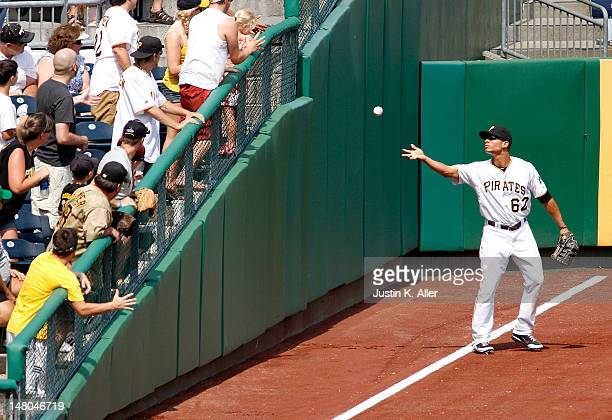 Gorkys Hernandez of the Pittsburgh Pirates tosses a ball into the crowd during the game against the San Francisco Giants on July 8 2012 at PNC Park...