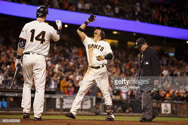 Gorkys Hernandez of the San Francisco Giants celebrates in front of Trevor Brown and umpire Jerry Meals after hitting a home run against the San...