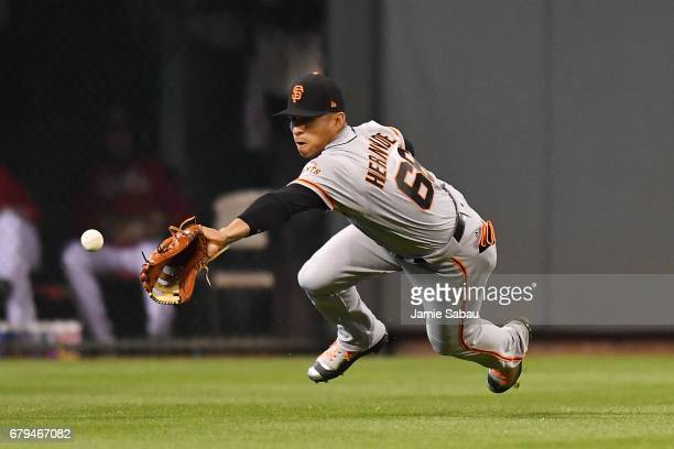 Gorkys Hernandez of the San Francisco Giants dives for and misses a ball hit to center field by Billy Hamilton of the Cincinnati Reds in the sixth...