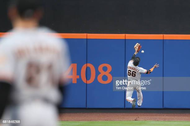 Gorkys Hernandez of the San Francisco Giants fails to get to a fly ball at left field during the San Francisco Giants Vs New York Mets regular season...