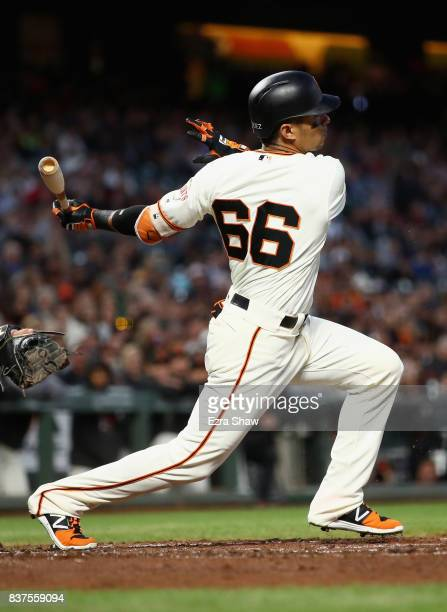 Gorkys Hernandez of the San Francisco Giants hits a single that scored Buster Posey in the second inning against the Milwaukee Brewers at ATT Park on...