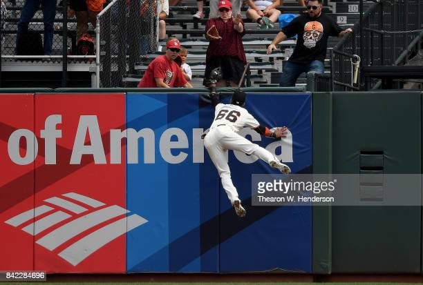 Gorkys Hernandez of the San Francisco Giants leaps at the wall to rob a home run away from Tommy Pham of the St Louis Cardinals in the top of the...