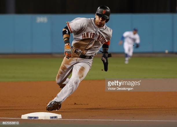 Gorkys Hernandez of the San Francisco Giants rounds third base on his way home to score on a single by Buster Posey to center field during the MLB...