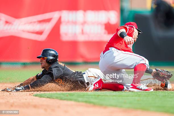 Gorkys Hernandez of the San Francisco Giants steals second base during a spring training game against the Los Angeles Angels of Anaheim at Scottsdale...