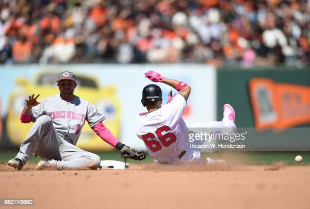 Gorkys Hernandez of the San Francisco Giants steals second base as the ball is thrown into center field past Jose Peraza of the Cincinnati Reds in...