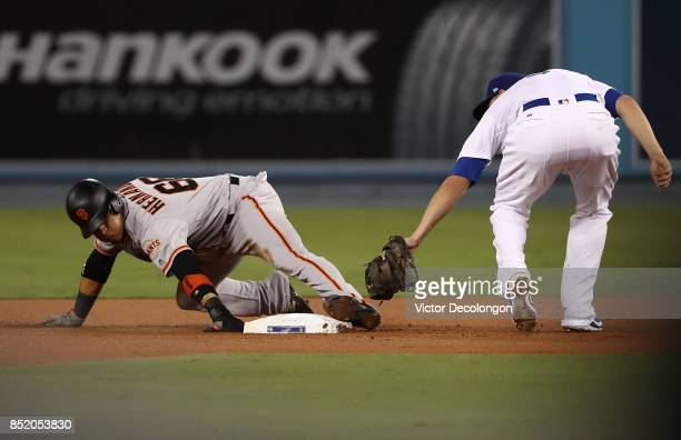 Gorkys Hernandez of the San Francisco Giants steals second base during the first inning of the MLB game against the Los Angeles Dodgers at Dodger...