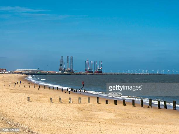Gorleston beach with outer harbour and wind farm