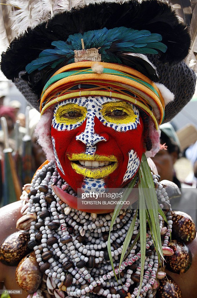 A Warakagul woman displays her shell necklace and plumed headdress during the 50th Goroka singsing in what is believed to be the largest gathering of...