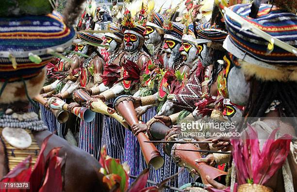Kunai warriors adorned with bird of paradise headdresses march to the 50th Goroka singsing in what is believed to be the largest gathering of...
