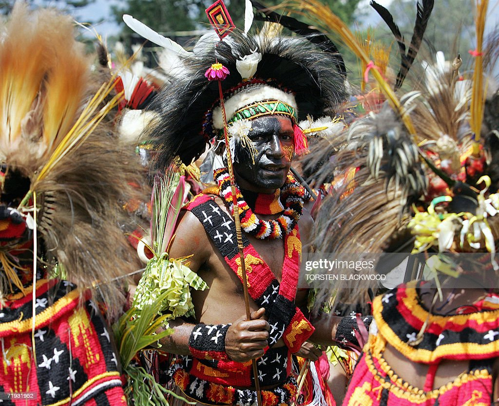 The Sogomie tribe wear the national colours of blackred and yellow during the 50th Goroka singsing in what is believed to be the largest gathering of...