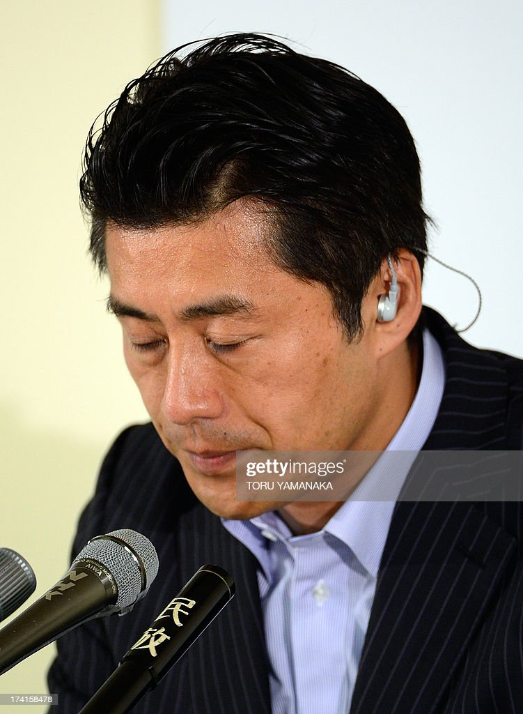 <a gi-track='captionPersonalityLinkClicked' href=/galleries/search?phrase=Goshi+Hosono&family=editorial&specificpeople=7721605 ng-click='$event.stopPropagation()'>Goshi Hosono</a>, secretary-general of the main opposition Democratic Party of Japan (DPJ), listens to question from a TV anchorman reporting results of the upper house election of parliament at the DPJ headquarters in Tokyo on July 21, 2013. Voters gave Prime Minister Shinzo Abe a resounding victory in upper house elections Sunday, exit polls showed, likely ushering in a new period of stability for politically volatile Japan. AFP PHOTO/Toru YAMANAKA