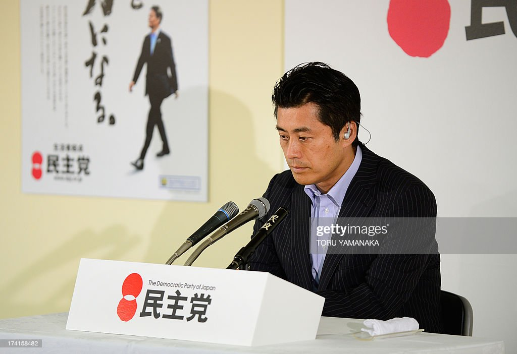 <a gi-track='captionPersonalityLinkClicked' href=/galleries/search?phrase=Goshi+Hosono&family=editorial&specificpeople=7721605 ng-click='$event.stopPropagation()'>Goshi Hosono</a>, secretary-general of the main opposition Democratic Party of Japan (DPJ), looks at a TV monitor reporting results of the upper house election of parliament at the DPJ headquarters in Tokyo on July 21, 2013. Voters gave Prime Minister Shinzo Abe a resounding victory in upper house elections Sunday, exit polls showed, likely ushering in a new period of stability for politically volatile Japan. AFP PHOTO/Toru YAMANAKA