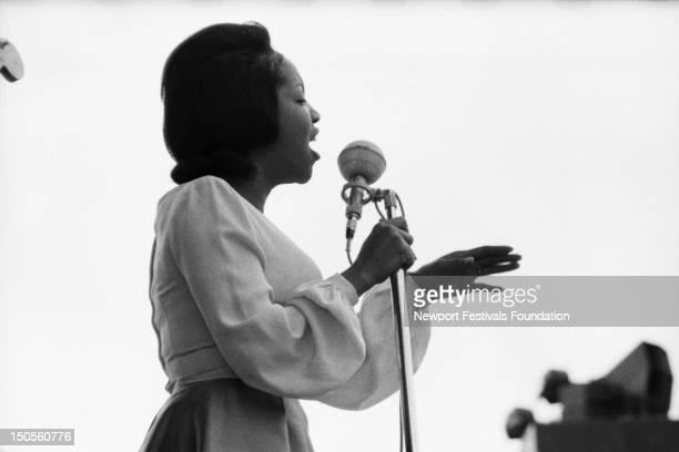 Gospel and soul singer Mavis Staples performs in July 1964 at the Newport Folk Festival in Newport Rhode Island