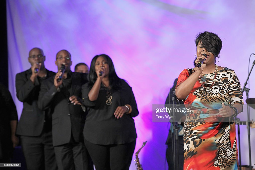 Gospel musician Sheri Jones-Moffett (R), Cameron Walls, Patrick Dailey and Brittany Spencer perform onstage during NMAAM's Celebration Of Legends Red Carpet And Luncheon on May 6, 2016 in Nashville, Tennessee.
