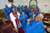 Gospel Singer Leading a Choir in a Church Service