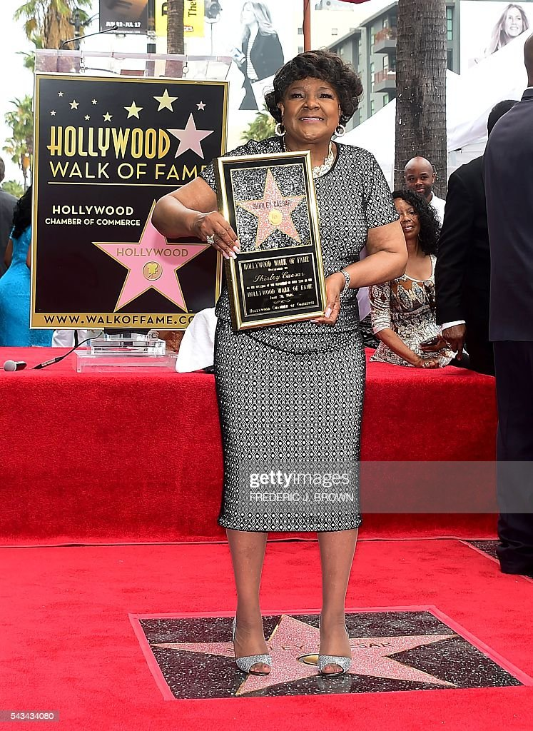 Gospel singer Shirley Caesar poses on her newly unveiled the Hollywood Walk of Fame star during ceremonies June 28, 2016 in Hollywood, California, where she was the recipient of the 2,583rd star in the category of Recording. Ceasar has performed for the late Nelson Mandela and every US President since Jimmy Carter. / AFP / Frederic J. BROWN