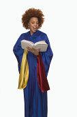 Gospel singer singing from hymnal