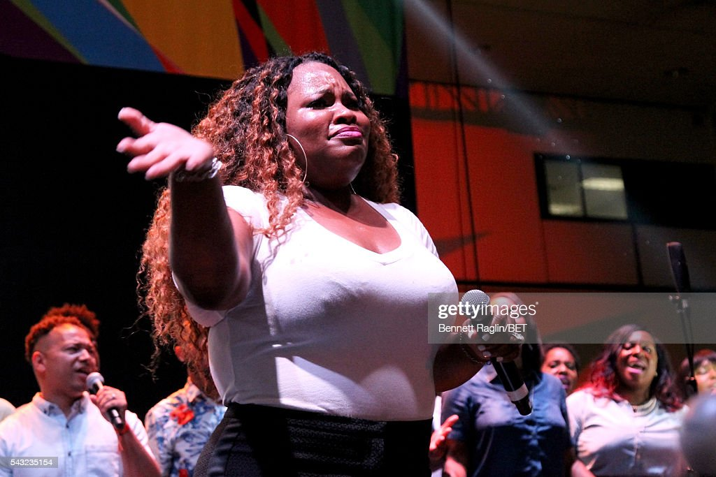 Gospel singer <a gi-track='captionPersonalityLinkClicked' href=/galleries/search?phrase=Tasha+Cobbs&family=editorial&specificpeople=11486733 ng-click='$event.stopPropagation()'>Tasha Cobbs</a> performs on the BETX stage during the 2016 BET Experience on June 26, 2016 in Los Angeles, California.